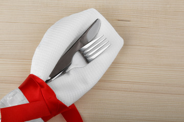 knife and fork on a napkin