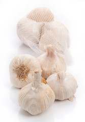 bunch of white heads of garlic