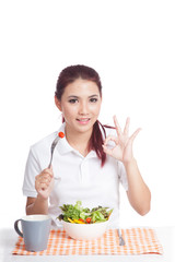 Asian girl eat salad show ok hand sign