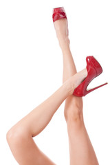 Sexy bare female legs in elegant red stilettos