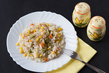 Rice with Vegetables and Salt and Pepper Shakers