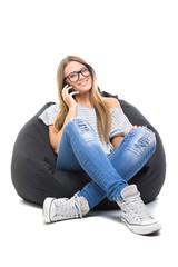 Teenage student girl with eyeglasses speaking on the phone