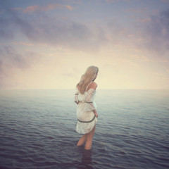 Beautiful girl in the water. Beach, sunset, evening. concept