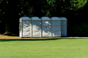 Five white portaloos