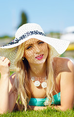 beautiful woman in hat on summer vacation