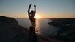 Stunner girl dancing oriental dance at sunset