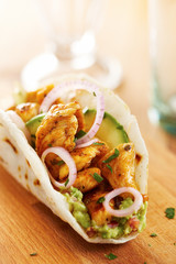 Mexican chicken taco with avocado