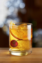Old fashioned cocktail with a cherry