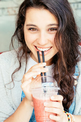 Beautiful girl drinking a smoothie