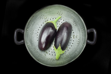 Colander with two eggplants