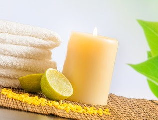 Spa massage border background with towel stacked and lime
