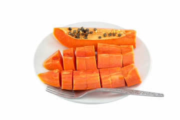 Papaya fruit in dish Isolated on white background