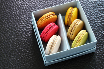 Colorful Macarons In The Paper Box