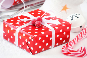 Christmas red polka dot present tied with white ribbon