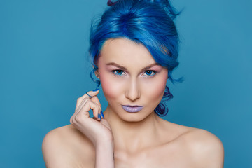 Portrait of beautiful girl with blue hair