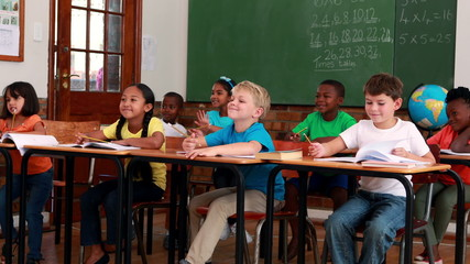 Pupils listening and writing during class