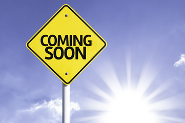 Coming Soon road sign with sun background