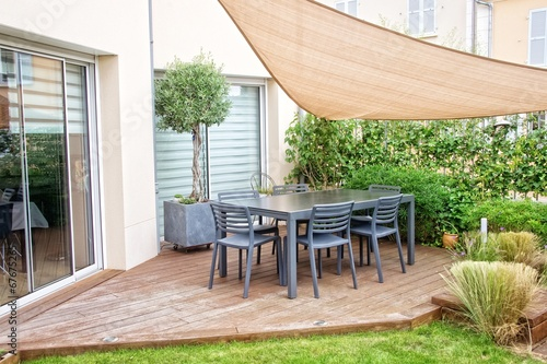 Modern terrace with dining table and chairs - 67675265