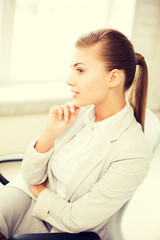 pensive woman in office
