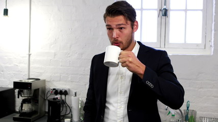 Handsome businessman having a coffee break
