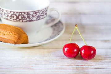 Coffee, cake and cherries.