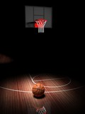 Basketball hoop with ball on wooden court floor
