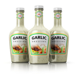 Set of bottles with garlic dressing