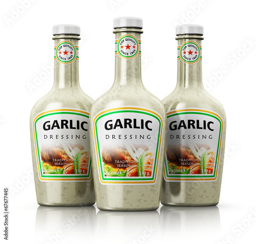 canvas print picture Set of bottles with garlic dressing