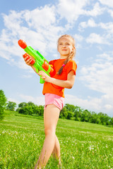 Nice kid girl with a water gun
