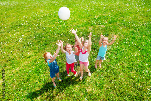 Kids playing ball on a meadow