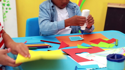 Cute little boys having art time in the classroom
