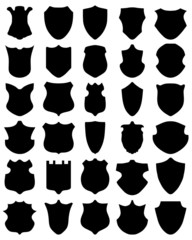 Black silhouettes of different shields, vector illustration