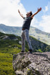 Happy young man in the mountains
