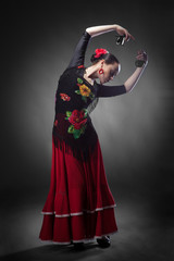 woman dancing flamenco with castanets