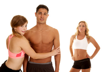 fitness man with two women one mad