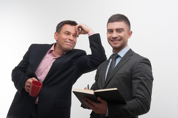 Senior and junior business people discuss something