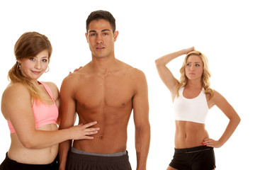 fitness man with two women one touch abs
