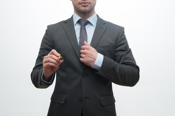 Closeup portrait of young handsome businessman in suit writing s