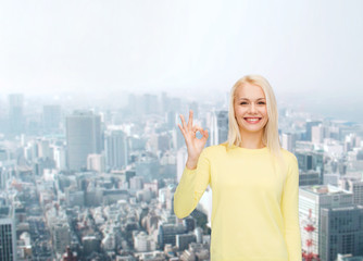 young businesswoman showing ok sign