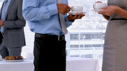 Business people standing and having coffee