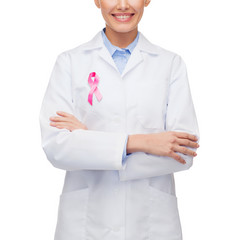 female doctor with breast cancer awareness ribbon