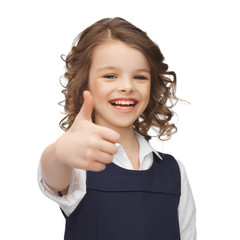 pre-teen girl showing thumbs up