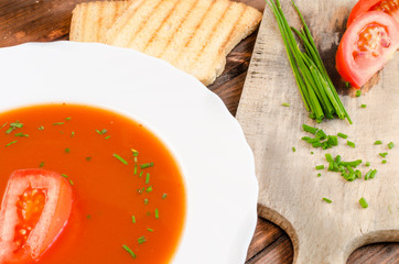 Tomato soup with toast and chive