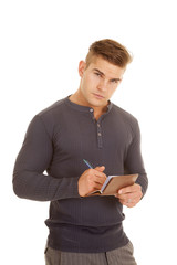 man gray long sleeve shirt write out check serious