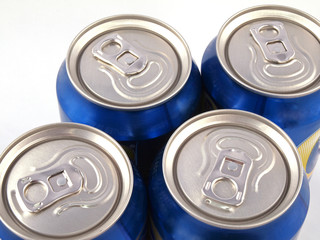 Close up of ring pulls on the tops of drink cans.