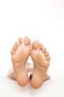 nice pedicure female feet on white background