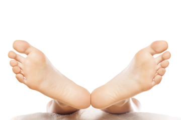 widespread female feet on white background