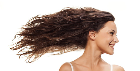 Pretty girl with long blowing wavy hair