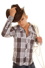 man plaid shirt rope western hat put on