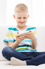 smiling little boy with smartphone
